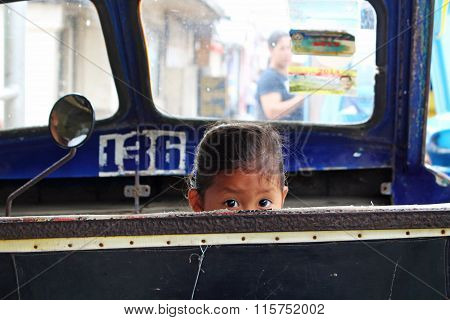 Child looking from a tricycle