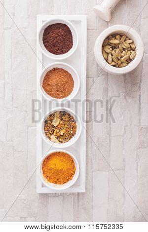 Colorful Indian spices with mortars and pestle