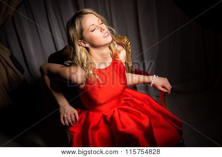 Sensual woman sitting in fancy chair