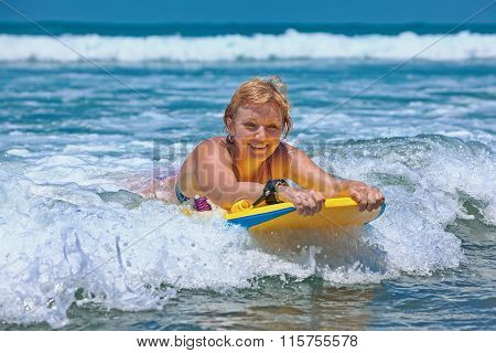 Positive Elder Woman Surfing With Fun On Ocean Waves