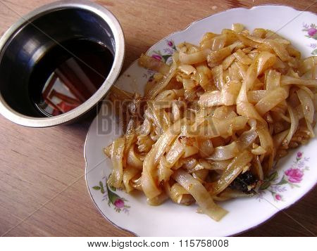 Chinese fried flat rice noodles