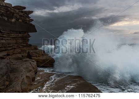 Big Waves Crashing Against Cliffs