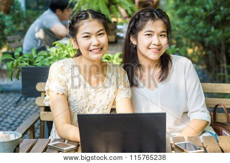 Two Asian Young Female Friends Use Internet Together