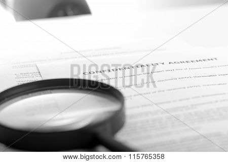 Search with magnifying glass, looking for information in books, blueprints, magazines. Audit inspect