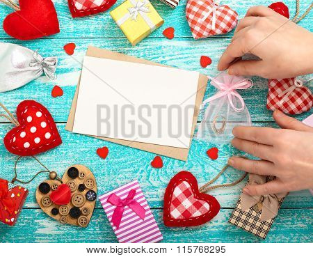 Woman Decorate Shop Window For Valentine's Day. Mock Up For Text