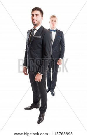 Two Suited Male Models Wearing Necktie And Bowtie.