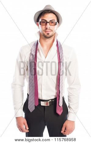 Two Neckties Hanging On Male Model Wearing Glasses And Hat.