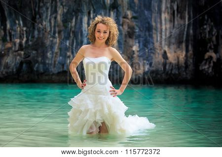 Closeup Blonde Bride In Fluffy Hands On Waist In Shallow Sea