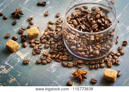 Bank Of Coffee Beans On The Old Wooden Background