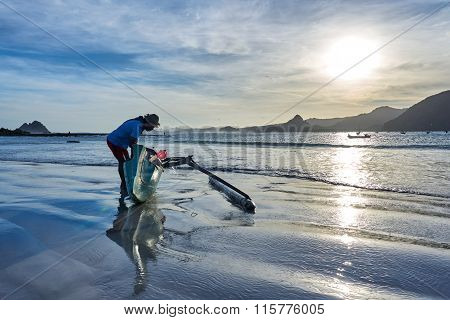 Man Prepare For Fishing With Boat At Broad Daylight