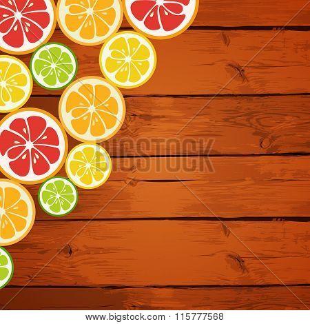 Lemon, lime, orange and grapefruit on wooden background