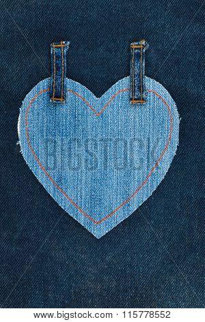Heart Made Of Denim Fabric With Yellow Stitching On Dark Denim
