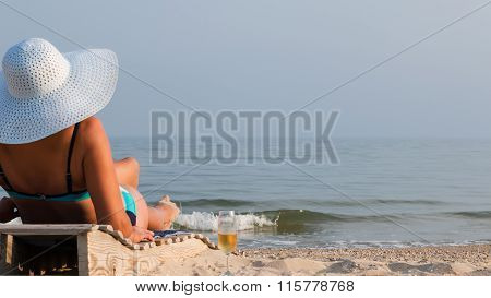 Woman On A Lounger In The Hat