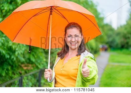Satisfied Woman With Umbrella On The Walk In The Park