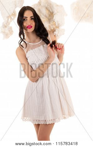 beautiful woman in a white dress in the clouds