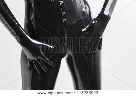 detail of standing woman wearing latex clothes