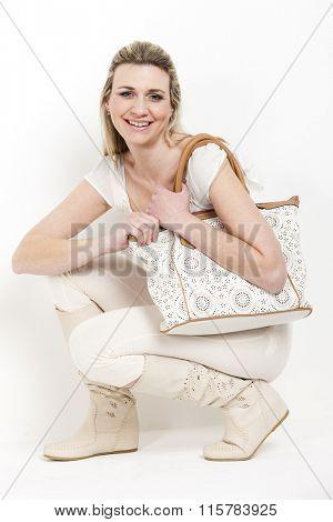 woman wearing summer boots with a handbag