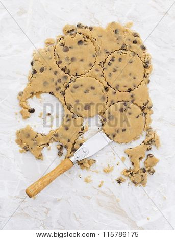 Circles In Chocolate Chip Cookie Dough With Palette Knife