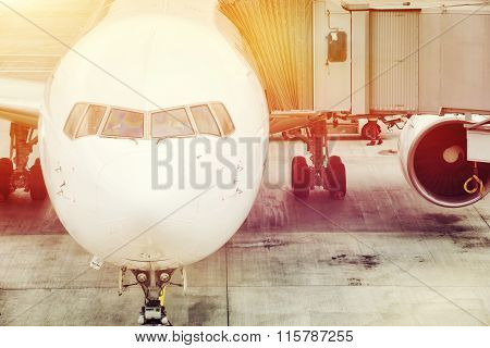 Airplane ready for boarding in a airport hub.