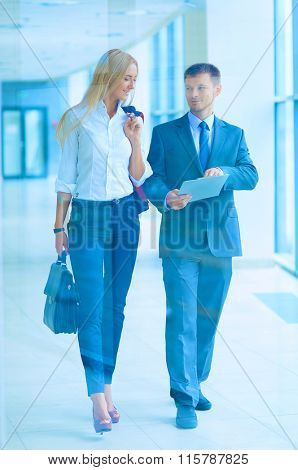 Business people walking in the corridor of an business center