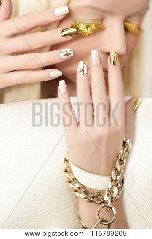 Gold manicure .