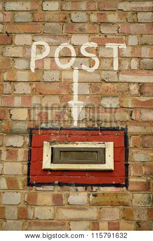Postbox in the wall
