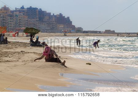Unidentified Local People Having Rest On The Local Beach On A Sunny Summer Day On October 13, 2014 I