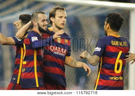 BARCELONA - JAN, 13: FC Barcelona players Aleix Vidal, Rakitic and Alves celebrating goal during a Spanish Cup match against RCD Espanyol at the Power8 stadium on January 13, 2016 in Barcelona, Spain