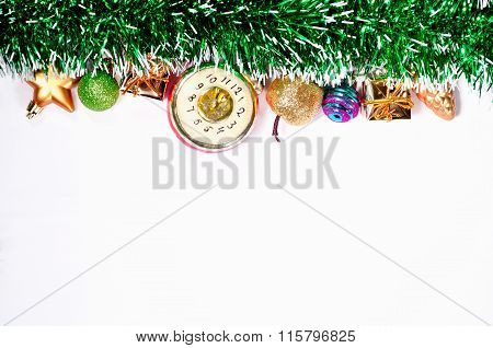 Festive Christmas Toys And Green Tinsel Bright Garland Isolated On White Background.