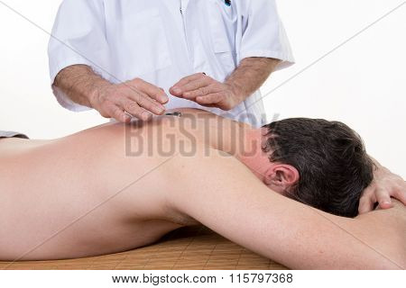 Male Healer Standing Behind Supine Male Client With Hands Isolated