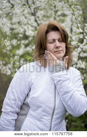 woman with a toothache on the nature
