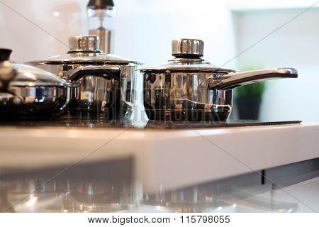 Stainless Steel Saucepans On Modern Kitchen