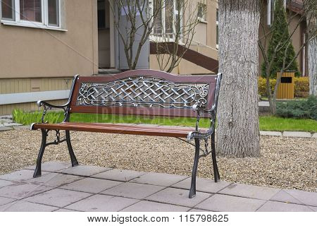 Beautiful bench in front of house