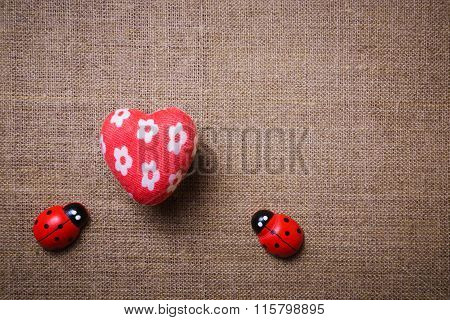 Heart and ladybug on the fabric.