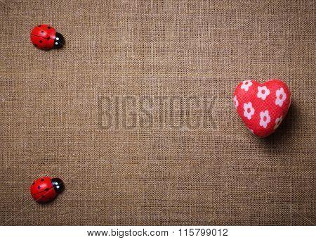 Heart and ladybug on the fabric.