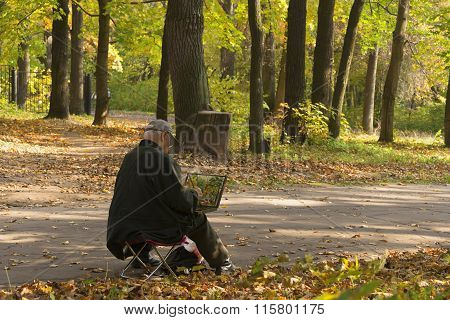 Painter In The Autumn Park