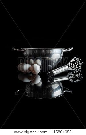 Steel bowl whisker eggs side view with reflection vertical black
