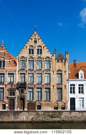 Facade Of Flemish Houses And Canal In Brugge
