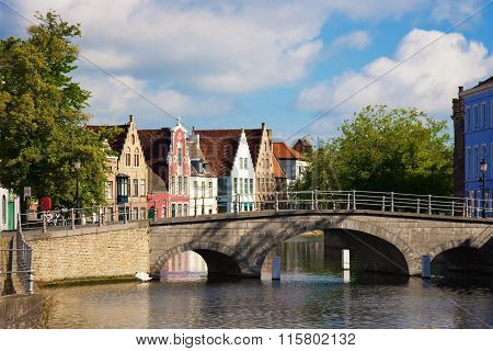 Flemish Houses And Bridge Over Canal In Brugge, Belgium