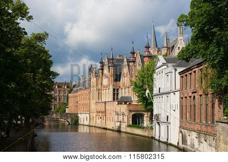 Medieval Bridge Over Canal And Flemish Houses In Brugge, Belgium