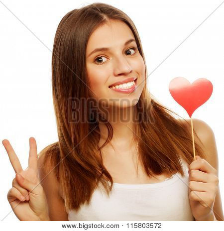 woman holding red paper heart