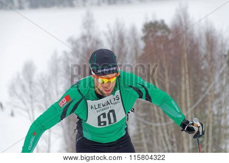 Close Up Of A Cross Country Skiing Man Dressed In Green