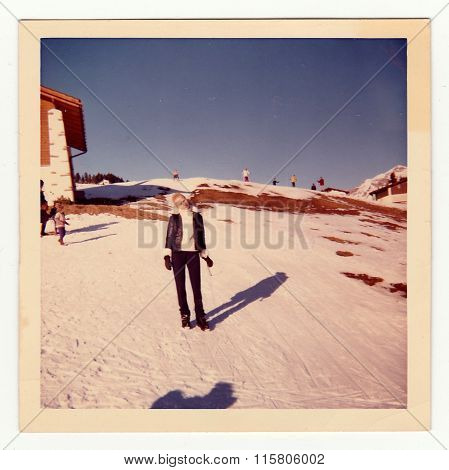 Vintage photo shows woman on winter vacation circa 1970s.