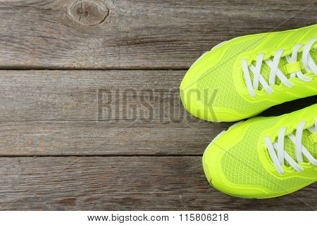 Pair Of Sport Shoes On Grey Wooden Background
