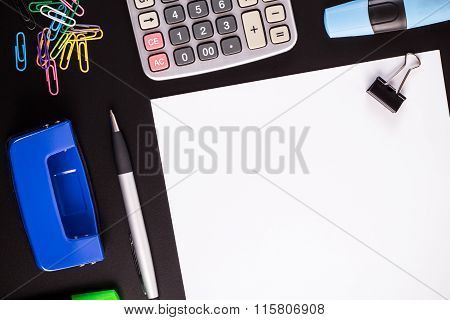 Office Supplies On Black Desk