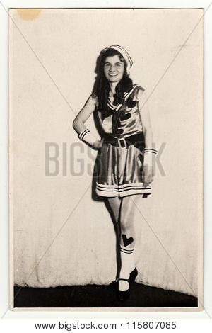 Vintage portrait photo shows young girl in a retro carnival costum (marine costum). Photo studio po