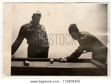 A vintage photo shows soldiers play pool, circa 1965.