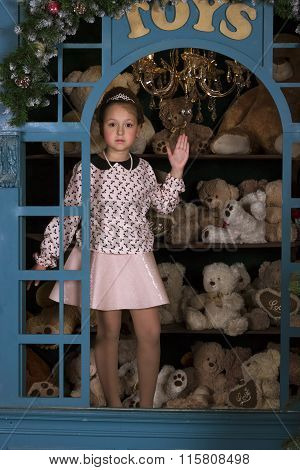 Girl Portrays A Porcelain Doll In The Window With Plush Bears