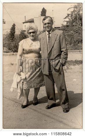Vintage photo shows marital couple, circa 1970s.