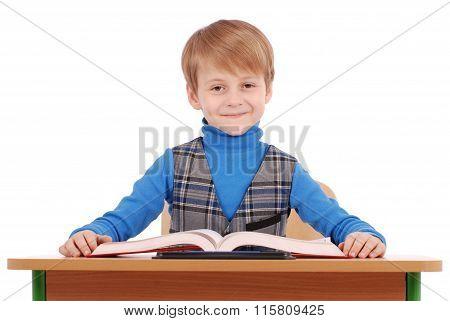 Boy Sitting At A School Desk